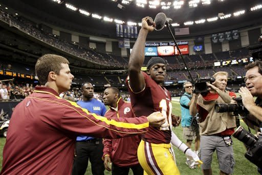 Washington Redskins quarterback Robert Griffin III (10) reacts to the crowd after an NFL football game against the New Orleans Saints at Mercedes-Benz Superdome in New Orleans, Sunday, Sept. 9, 2012. The Redskins won 40-32. (AP Photo/Matthew Hinton)