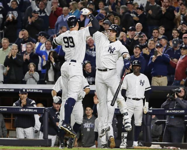 New York Yankees' Aaron Judge (99) celebrates with Gary Sanchez after hitting a two-run home run during the fourth inning of the American League wild-card baseball game against the Minnesota Twins on Tuesday, Oct. 3, 2017, in New York. (AP)