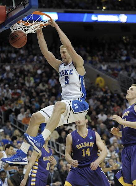 FILE - Duke's Mason Plumlee (5) dunks the ball past Albany's Luke Devlin (11), Sam Rowley (14) and Jacob Iati (0) during the second half of a second-round game of the NCAA college basketball tournament, in this March 22, 2013 file photo taken in Philadelphia. (AP Photo/Michael Perez, File)