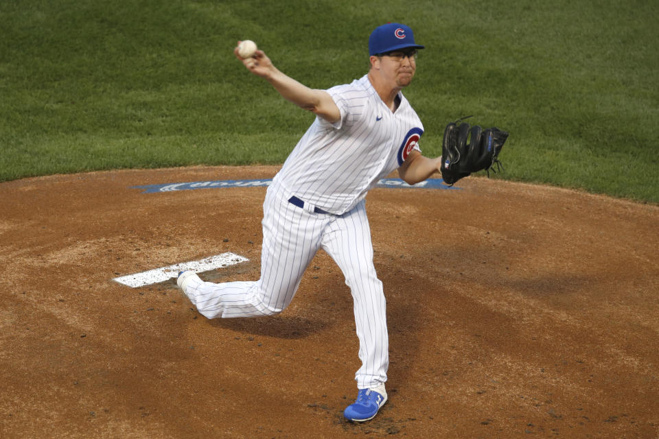 Chicago Cubs starting pitcher Alec Mills delivers during the first inning of a baseball game against the Milwaukee Brewers, Friday, Aug. 14, 2020, in Chicago. (AP Photo/Jeff Haynes)