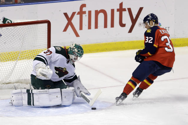 Minnesota Wild goalie Josh Harding (37) stops a shot by Florida Panthers right wing Kris Versteeg (32) in the first period of an NHL hockey game, Saturday, Oct. 19, 2013, in Sunrise, Fla. (AP Photo/Alan Diaz)