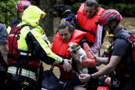 Residents of the Crescent at Lakeshore apartment complex are rescued by Homewood Fire and Rescue as severe weather produced torrential rainfall flooding several apartment buildings Tuesday, May 4, 2021 in Homewood, Ala. (AP Photo/Butch Dill)