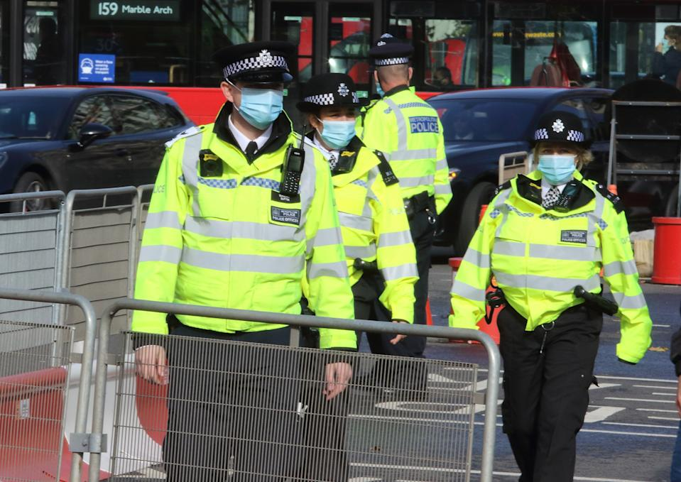 Policemen are seen wearing facemasks around Parliament Square. Public people are seen wearing facemasks while out shopping in London following prime minister, Boris Johnson's announcement of a new three tier lockdown system because of the increasing cases of coronavirus infections in the UK. (Photo by Keith Mayhew / SOPA Images/Sipa USA)