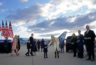 Ivanka Trump (C), husband Jared Kushner (C-L), their children, Eric (R) and Donald Jr. (2nd R), Tiffany Trump (L) and Trump family members stand on the tarmac at Joint Base Andrews in Maryland as they arrive for US President Donald Trump's departure on January 20, 2021. - President Trump travels to his Mar-a-Lago golf club residence in Palm Beach, Florida, and will not attend the inauguration for President-elect Joe Biden. (Photo by ALEX EDELMAN / AFP) (Photo by ALEX EDELMAN/AFP via Getty Images)