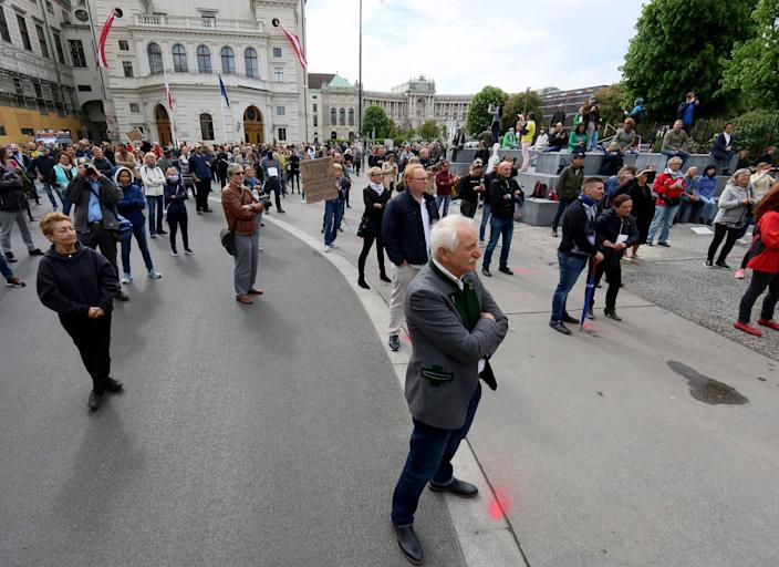 Participants obey social distancing rules during a demonstration against the measures of the Austrian government in Vienna on May 1, 2020. The Austrian government has moved to restrict freedom of movement for people, in an effort to slow the onset of the COVID-19 coronavirus.