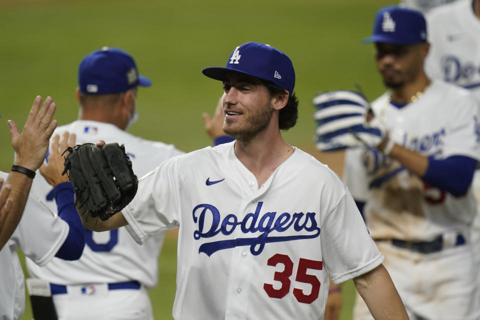 Los Angeles Dodgers center fielder Cody Bellinger celebrates their win against the Tampa Bay Rays in Game 1 of the baseball World Series Tuesday, Oct. 20, 2020, in Arlington, Texas. The Dodgers defeated the Rays 8-3 to lead the series 1-0 games. (AP Photo/Eric Gay)