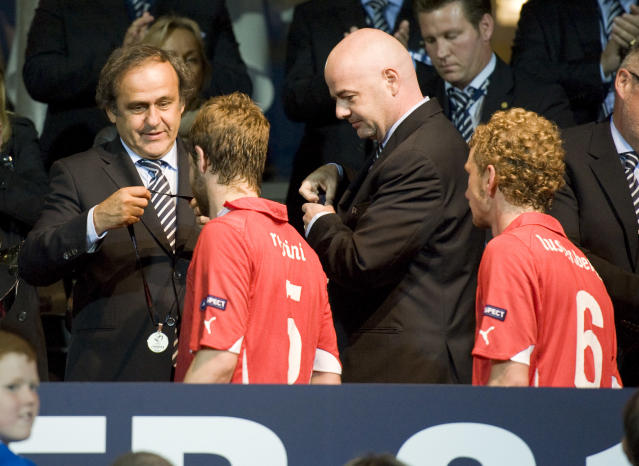 UEFA President Michel Platini (L) hands over a silver medal to Jonathan Rossini of Switzerland after Spain won the European Under-21 Championship final football match between Switzerland and Spain at NRGI Park Stadium in Arhus Stadion Denmark on June 25, 2011. AFP PHOTO/JONATHAN NACKSTRAND (Photo credit should read JONATHAN NACKSTRAND/AFP/Getty Images)