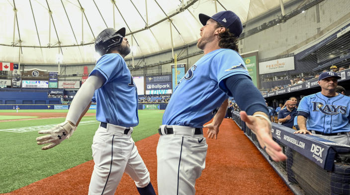 Tampa Bay Rays' Brett Phillips celebrates with Brandon Lowe, left, after Lowe's solo home run off Toronto Blue Jays starter Ross Stripling during the first inning of a baseball game Saturday, July 10, 2021, in St. Petersburg, Fla. (AP Photo/Steve Nesius)