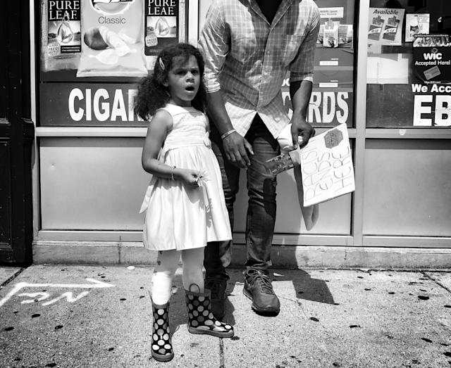 "<p>A young girl and her father at a counterprotest against a ""free speech"" rally staged by conservative activists Aug. 19 in Boston. (Photo: Holly Bailey/Yahoo News) </p>"