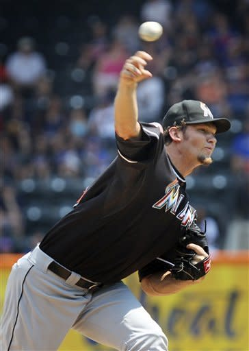 Miami Marlins' Josh Johnson pitches during the first inning of a baseball game against the New York Mets, Thursday, Aug. 9, 2012, at Citi Field in New York. (AP Photo/Seth Wenig)