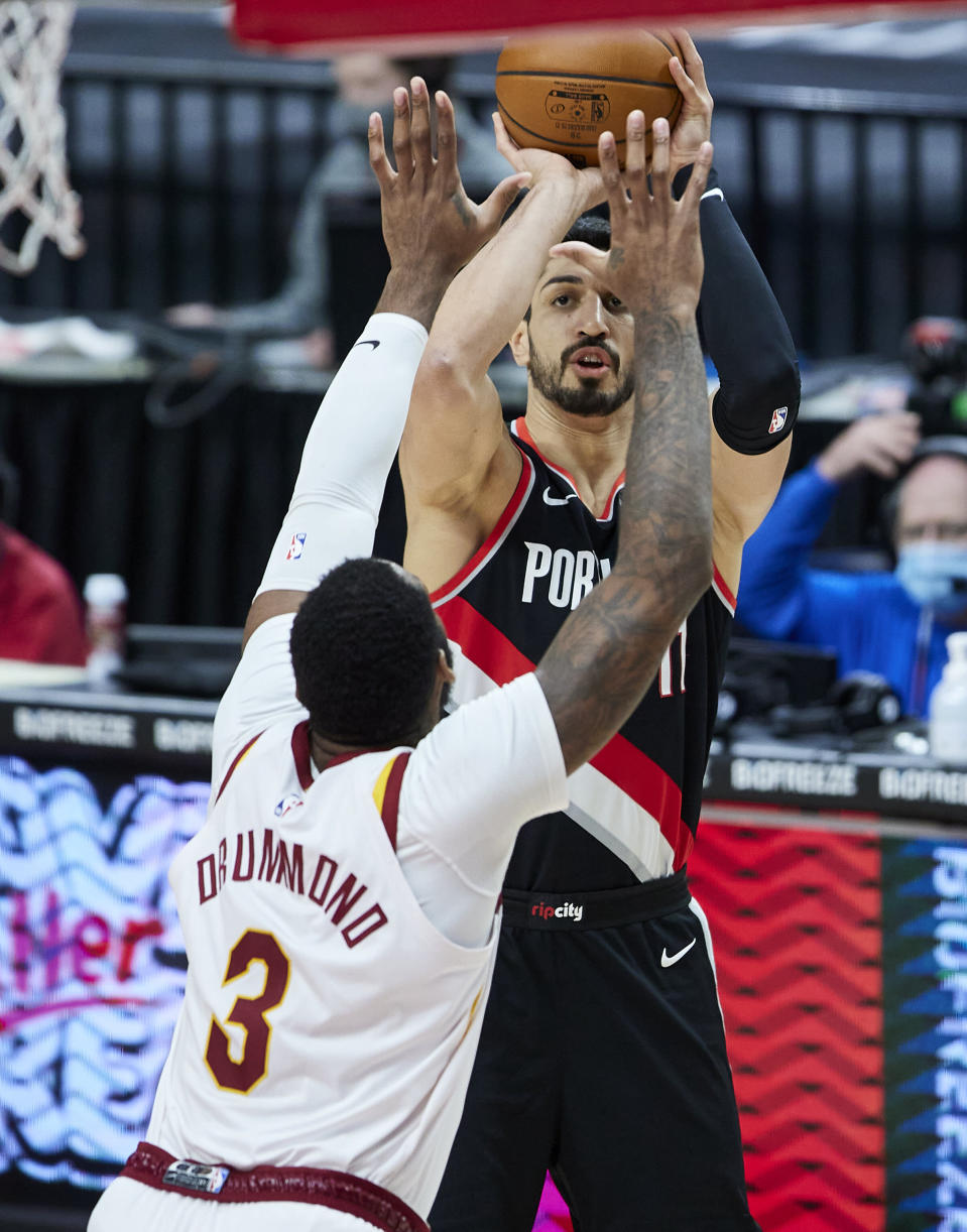 Portland Trail Blazers center Enes Kanter, right, shoots over Cleveland Cavaliers center Andre Drummond during the second half of an NBA basketball game in Portland, Ore., Friday, Feb. 12, 2021. (AP Photo/Craig Mitchelldyer)
