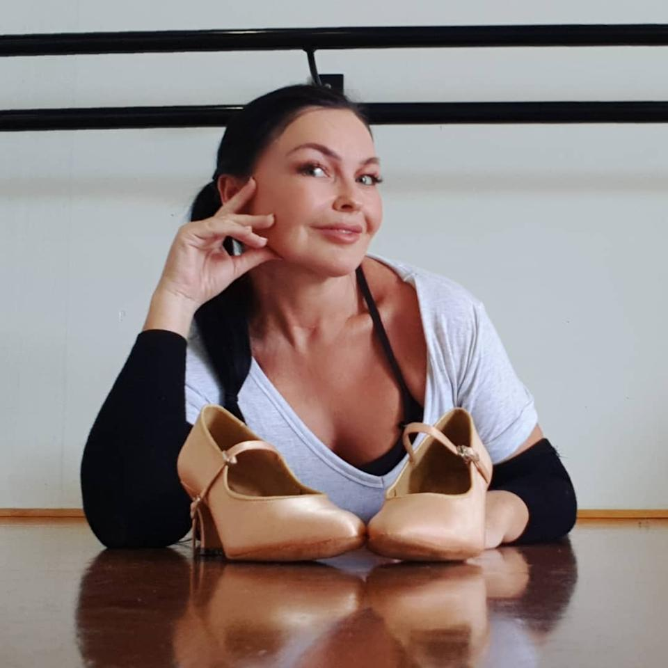 Schapelle Corby posing with a pair of dancing shoes