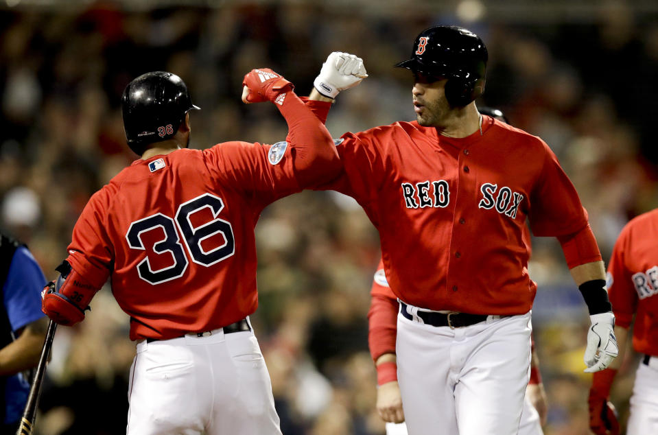 Boston Red Sox's J.D. Martinez celebrates after his three-run home run with Eduardo Nunez during the first inning of Game 1 of a baseball American League Division Series against the New York Yankees on Friday, Oct. 5, 2018, in Boston. (AP Photo/Charles Krupa)