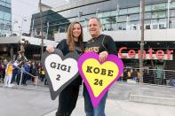 Alyssa Shapiro, 27, of Huntington Beach, and her father Rick Shapiro, 55, stood outside holding posters in honor of the late father and daughter.