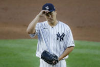 New York Yankees starting pitcher Masahiro Tanaka adjusts his padded protective cap during the third inning of the team's baseball game against the Boston Red Sox, Saturday, Aug. 1, 2020, in New York. (AP Photo/John Minchillo)