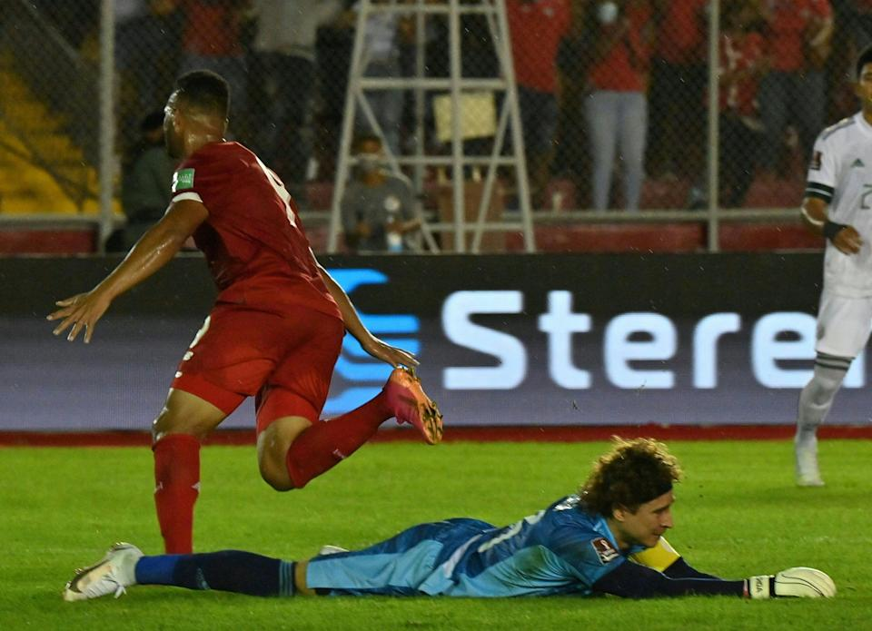 Panama's Rolando Blackburn (L) celebrates after scoring against Mexico's goalkeeper Guillermo Ochoa during their Qatar 2022 FIFA World Cup Concacaf qualifier match at the Rommel Fernandez stadium in Panama City, on September 8, 2021. (Photo by Luis ACOSTA / AFP) (Photo by LUIS ACOSTA/AFP via Getty Images)