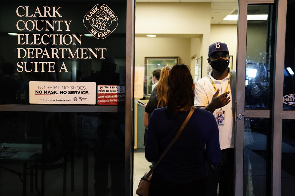 Voters waits to be allowed in to check or fix their ballots at the Clark County Election Department after the Nov. 3 elections, Friday, Nov. 6, 2020, in North Las Vegas, Nev. (AP Photo/Jae C. Hong)
