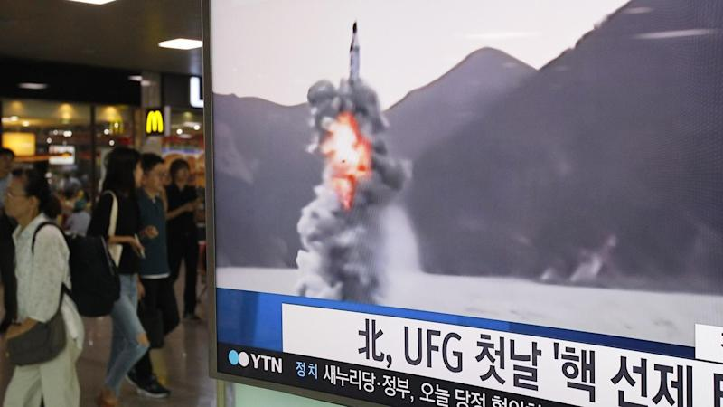 North Korea has fired a submarine-launched missile that flew about 500 km towards Japan.