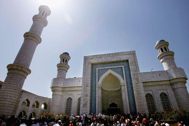 <b>ALMATY, KAZAKHSTAN:</b> Islamic worshippers gather outside the Great Mosque during Friday Muslim prayers in Almaty in the central Asian republic of Kazakhstan. It was completed in 1999 after six years of construction on the site of an old mosque. Under Soviet communist rule, religion was suppressed in Kazakhstan and many other countries of the former USSR.