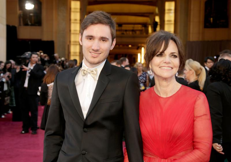 Sam Greisman (L) and Sally Field arrive at the Oscars in 2013.