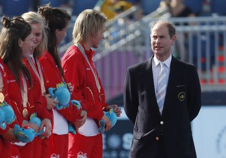 FILE PHOTO: Hockey - Gold Coast 2018 Commonwealth Games - Gold Coast Hockey Centre - Gold Coast, Australia - April 14, 2018. Britain's Prince Edward with the bronze medallist England team during the medals ceremony. REUTERS/David Gray