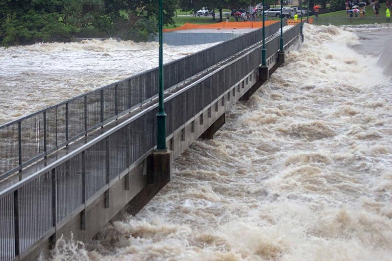 "The authorities were forced to open floodgates of a major dam late Sunday, unleashing what they called ""dangerous and high velocity flows"" (AFP Photo/Handout)"