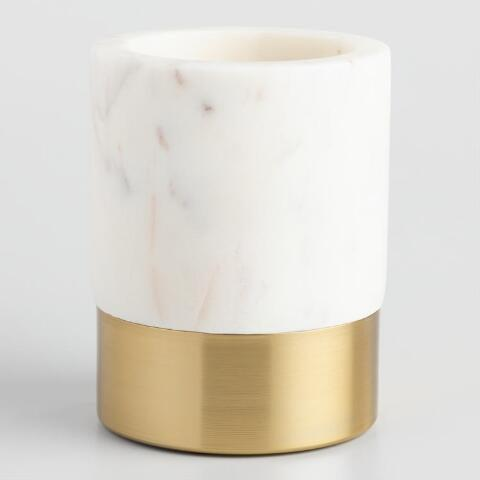 "<h2>Marble and Gold Metal Maxwell Pencil Cup</h2><br>A pencil cup for the fancy gal in your life. <br><br><strong>World Market</strong> Marble and Gold Metal Maxwell Pencil Cup, $, available at <a href=""https://go.skimresources.com/?id=30283X879131&url=https%3A%2F%2Fwww.worldmarket.com%2Fproduct%2Fmarble-and-gold-metal-maxwell-pencil-cup.do%3Fsortby%3DourPicks%26from%3Dfn"" rel=""nofollow noopener"" target=""_blank"" data-ylk=""slk:Cost Plus World Market"" class=""link rapid-noclick-resp"">Cost Plus World Market</a>"