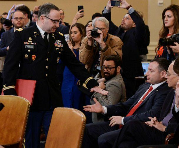 PHOTO: Lt. Colonel Alexander Vindman greets his twin brother Yevgeny Vindman sitting in the audience as Vindman arrives to give testimony as part of the impeachment inquiry into President Donald Trump on Capitol Hill in Washington, D.C., Nov. 19, 2019. (Erin Scott/Reuters)