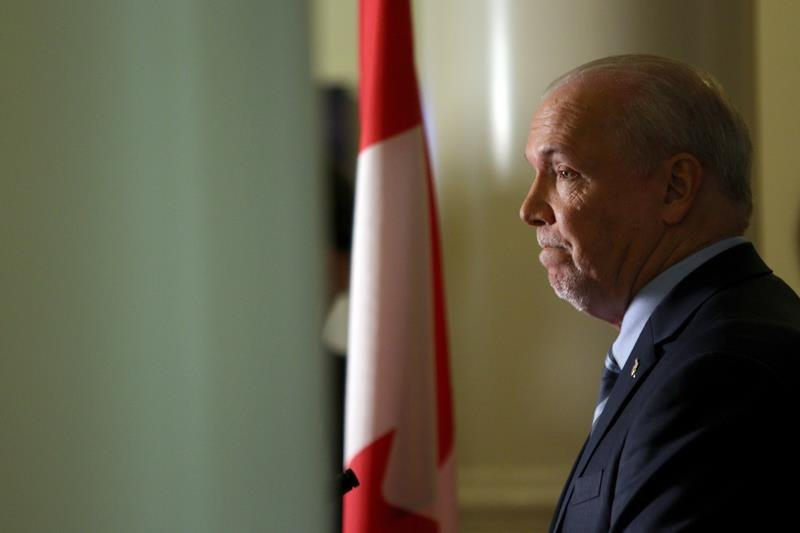 British Columbia premier defends chief of staff over handling of allegations