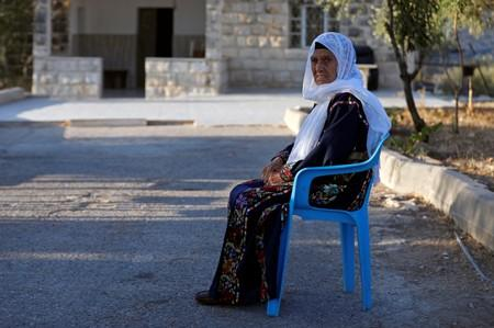 Muftia, the grandmother of U.S. congresswoman Rashida Tlaib, looks on as she sits outside her house in the village of Beit Ur Al-Fauqa in the Israeli-occupied West Bank