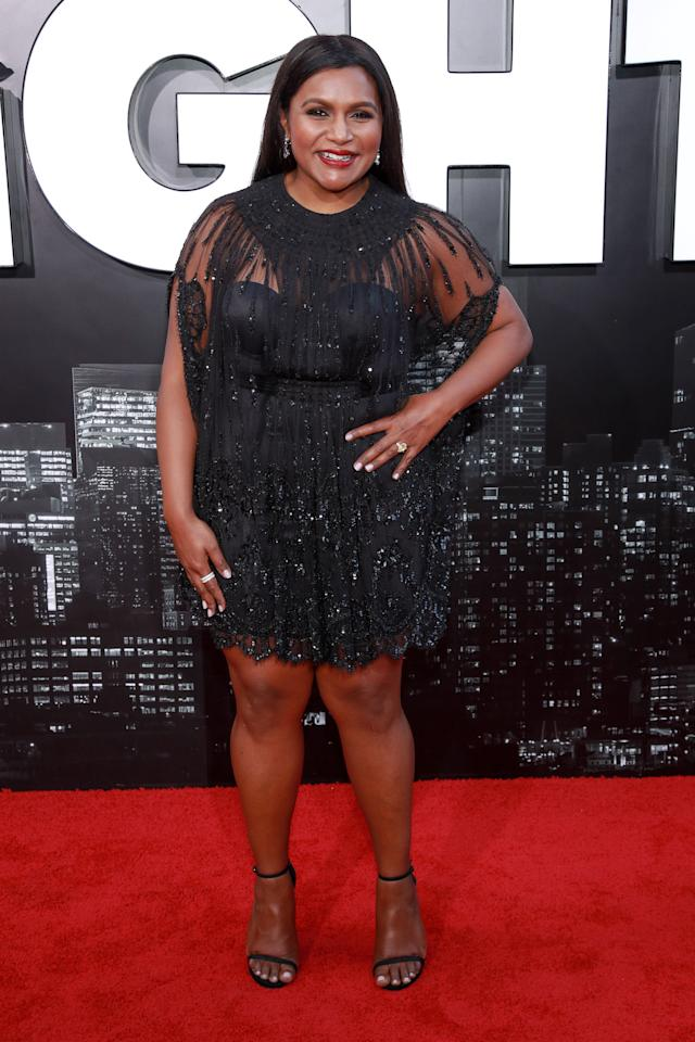 Actress Mindy Kaling lit up the red carpet in a glitzy Valentino mini dress paired with Stuart Weitzman heels. <em>[Photo: Getty]</em>