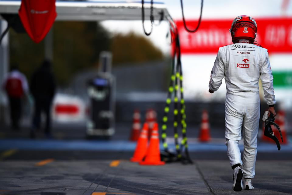 NUERBURG, GERMANY - OCTOBER 10: Kimi Raikkonen of Finland and Alfa Romeo Racing walks in the Pitlane during qualifying ahead of the F1 Eifel Grand Prix at Nuerburgring on October 10, 2020 in Nuerburg, Germany. (Photo by Mark Thompson/Getty Images)