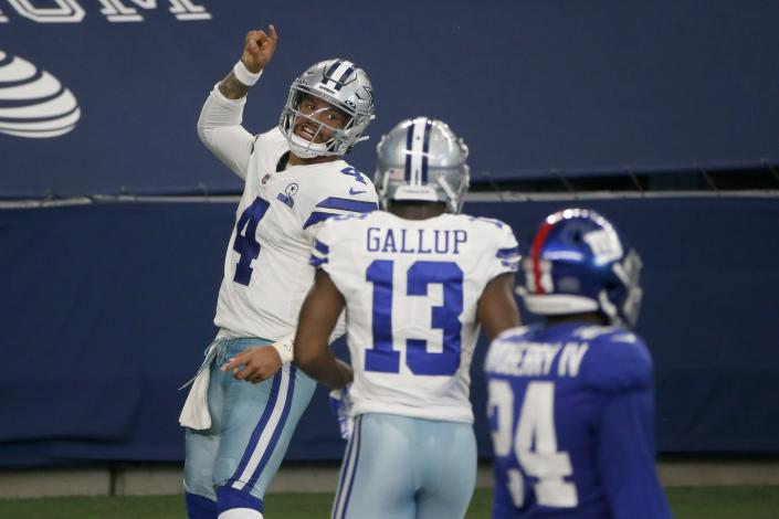 Dak Prescott was the first Dallas Cowboys quarterback to catch a touchdown pass since 1985. (AP Photo/Michael Ainsworth)
