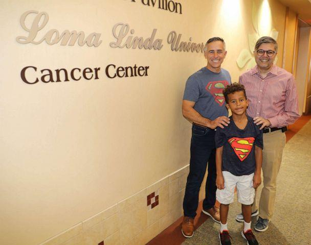 PHOTO: Jeff Sipos poses in a recent photo with first grader Jackson Todd, and his oncologist Dr. Muhammad Omair Kamal. (Heather Jackson/Loma Linda University Health)