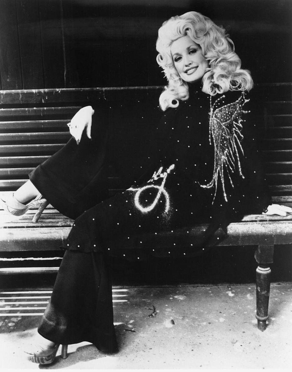 "<p>Parton poses in a glittery jumpsuit the same year her seminal album <em><a href=""https://www.amazon.com/Jolene-Expanded-Dolly-Parton/dp/B0045DO8K6?tag=syn-yahoo-20&ascsubtag=%5Bartid%7C10050.g.35033758%5Bsrc%7Cyahoo-us"" rel=""nofollow noopener"" target=""_blank"" data-ylk=""slk:Jolene"" class=""link rapid-noclick-resp"">Jolene</a> </em>shoots her to stardom. <em><br></em></p>"