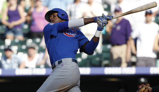 Chicago Cubs' Junior Lake strikes out against the Colorado Rockies to end the ninth inning of the Rockies' 4-3 victory in a baseball game in Denver, Sunday, July 21, 2013. (AP Photo/David Zalubowski)