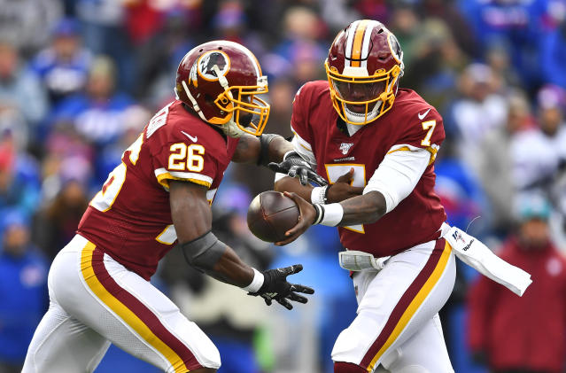 Washington Redskins quarterback Dwayne Haskins (7) hands the ball off to running back Adrian Peterson (26) during the first half of an NFL football game against the Buffalo Bills, Sunday, Nov. 3, 2019, in Orchard Park, N.Y. (AP Photo/Adrian Kraus)
