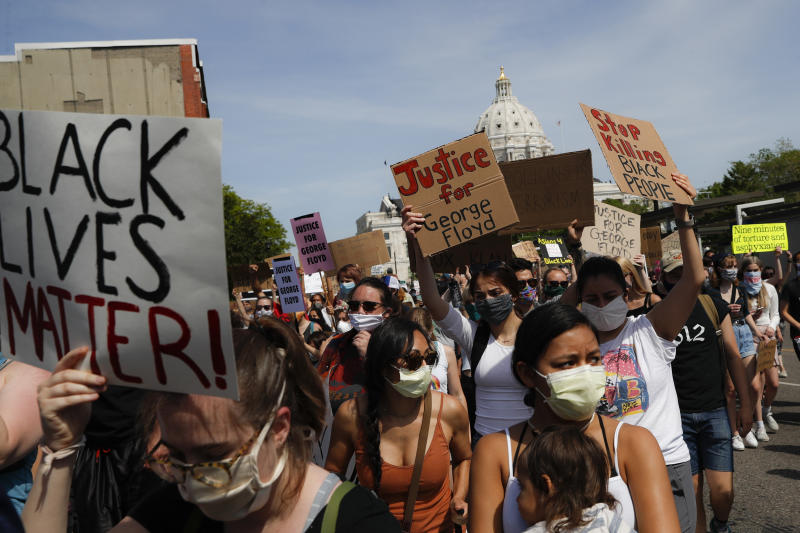 Protesters march away from the State Capitol, Sunday, May 31, 2020, in St. Paul, Minnesota, demanding justice for George Floyd. Source: AP