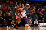 Carmelo Anthony (right) looks to pass in the post in the first half against Carlos Delfino and Brandon Jennings (foreground) of the Milwaukee Bucks at Madison Square Garden on March 26, 2012 in New York. (Photo by Chris Chambers/Getty Images)