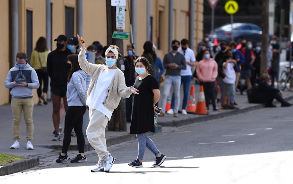 People queue at a Covid-19 testing station in Melbourne on August 19, as the city passed 200 days in hard lockdown since the start of the pandemic. Source: Getty