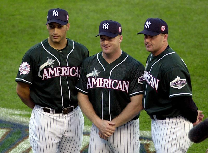 FILE - This July 9, 2001 file photo shows the American League New York Yankees pitchers, from left, Andy Pettitte, Mike Stanton and Roger Clemens, posing together for fans before the All-Star Home Run Derby at Safeco Field in Seattle. The key witness in the Roger Clemens perjury trial testified Monday, May 21, 2012, about three other baseball players who he said took human growth hormone. Brian McNamee, Clemens' longtime strength and conditioning coach, told jurors that he provided HGH to current Yankee pitcher Andy Pettitte and former Yankee infielder Chuck Knoblauch. McNamee also testified that former Yankee pitcher Mike Stanton obtained HGH from drug dealer Kirk Radomski, after McNamee put them in touch. (AP Photo/Bob Galbraith, File)