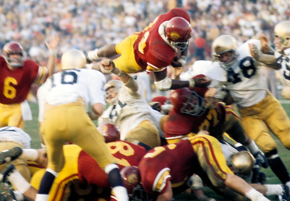 Sam Cunningham leaps over the pile against Notre Dame at the Los Angeles Memorial Coliseum during a gmae in 1972.