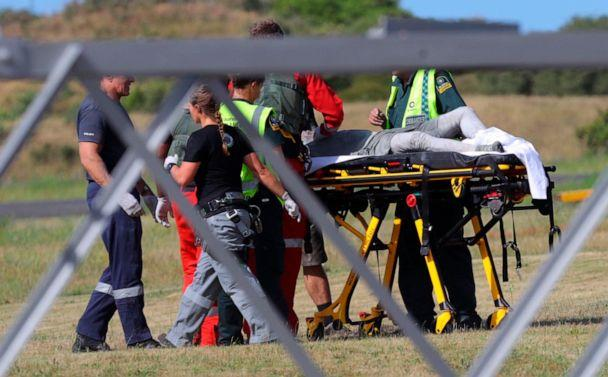 PHOTO: Emergency services attend to an injured person arriving at the airfield on White Island, New Zealand, after the volcanic eruption on Dec. 9, 2019. (Alan Gibson/New Zealand Herald via AP)