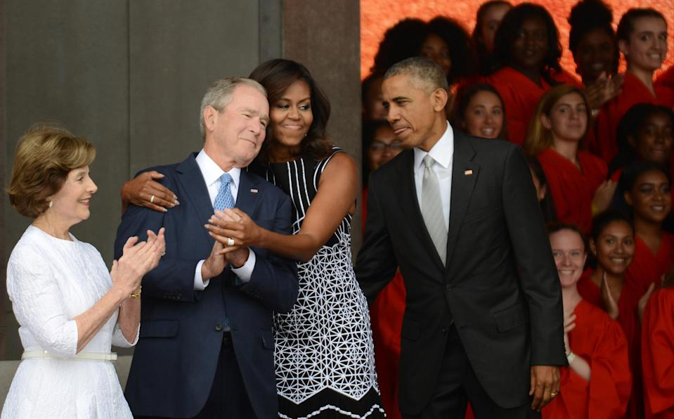 """Michelle Obama has called George W. Bush (pictured with her and their respective spouses, Laura Bush and Barack Obama) her """"partner in crime."""" (Photo: Astrid Riecken/Getty Images)"""