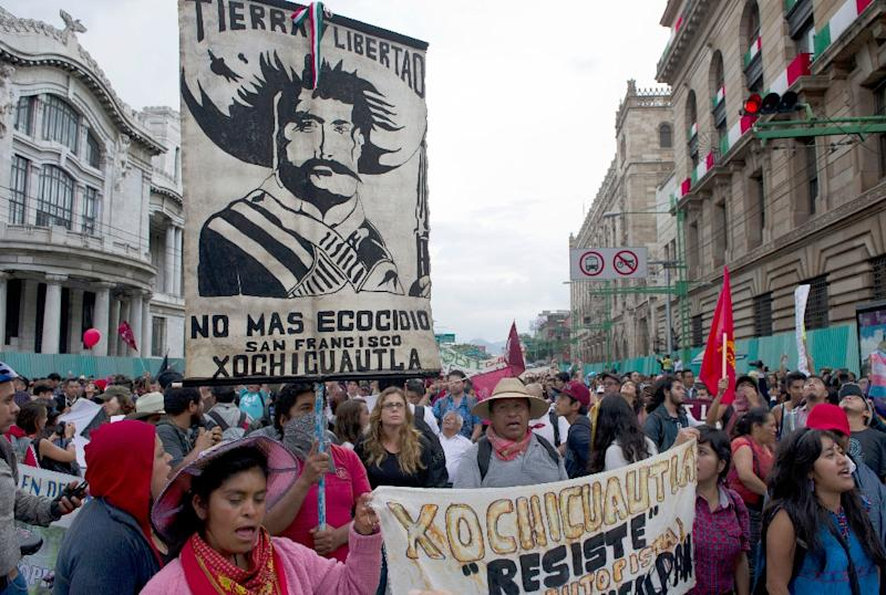 Students marched in October 2014 to commemorate the Tlatelolco massacre, a 1968 event in which Mexican security forces officially acknowledged killing only 44 protesters (AFP Photo/RONALDO SCHEMIDT)