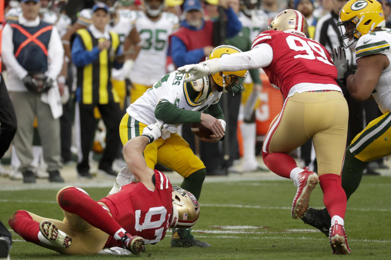 Green Bay Packers quarterback Aaron Rodgers is sacked by San Francisco 49ers defensive end Nick Bosa, Left, and defensive tackle DeForest Buckner during the first half of the NFL NFC Championship football game Sunday, Jan. 19, 2020, in Santa Clara, Calif. (AP Photo/Matt York)