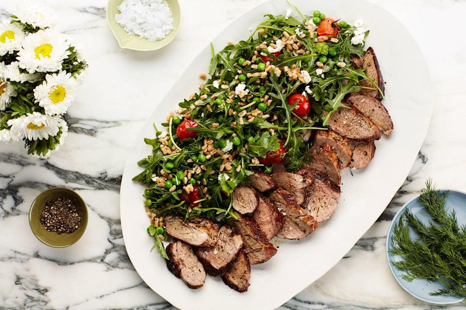"""This pork tenderloin dinner comes together fast, but is packed with the bright flavors of citrus and dill. Peas and lightly blistered tomatoes add sweetness while feta cheese adds tang to the farro and arugula salad. <a href=""""https://www.epicurious.com/recipes/food/views/dill-crusted-pork-tenderloin-with-farro-pea-and-blistered-tomato-salad?mbid=synd_yahoo_rss"""" rel=""""nofollow noopener"""" target=""""_blank"""" data-ylk=""""slk:See recipe."""" class=""""link rapid-noclick-resp"""">See recipe.</a>"""