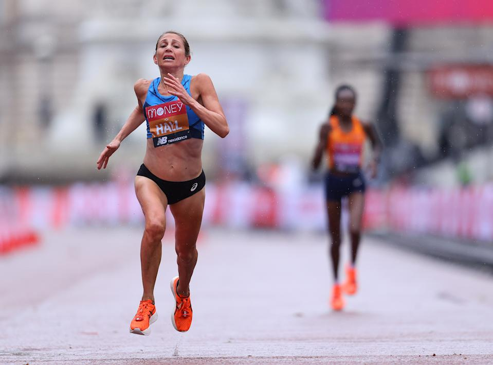 LONDON, ENGLAND - OCTOBER 04: Sara Hall of The United States of America sprints to cross the finish line in second place ahead of Ruth Chepngetich of Kenya in the Elite Women's Field during the 2020 Virgin Money London Marathon around St. James's Park on October 04, 2020 in London, England. The 40th Race will take place on a closed-loop circuit around St James's Park in central London. (Photo by Richard Heathcote/Getty Images)