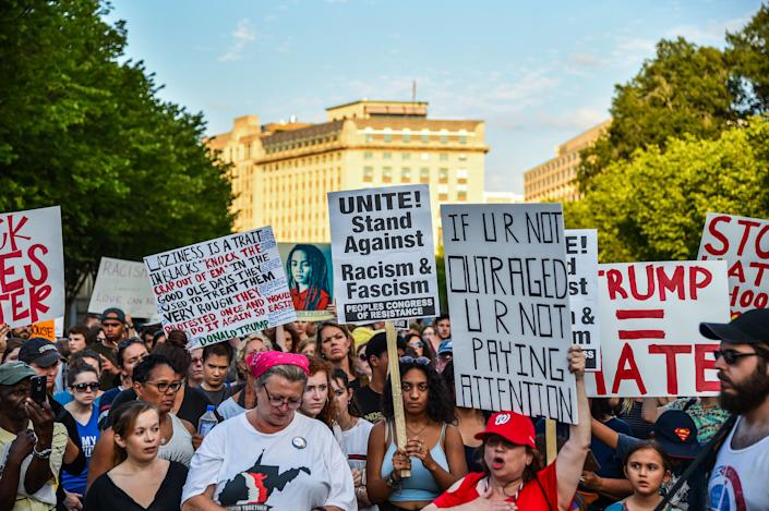 People gather in front of the White House to hold a vigil on Aug. 13, one day after the violence in Charlottesville.