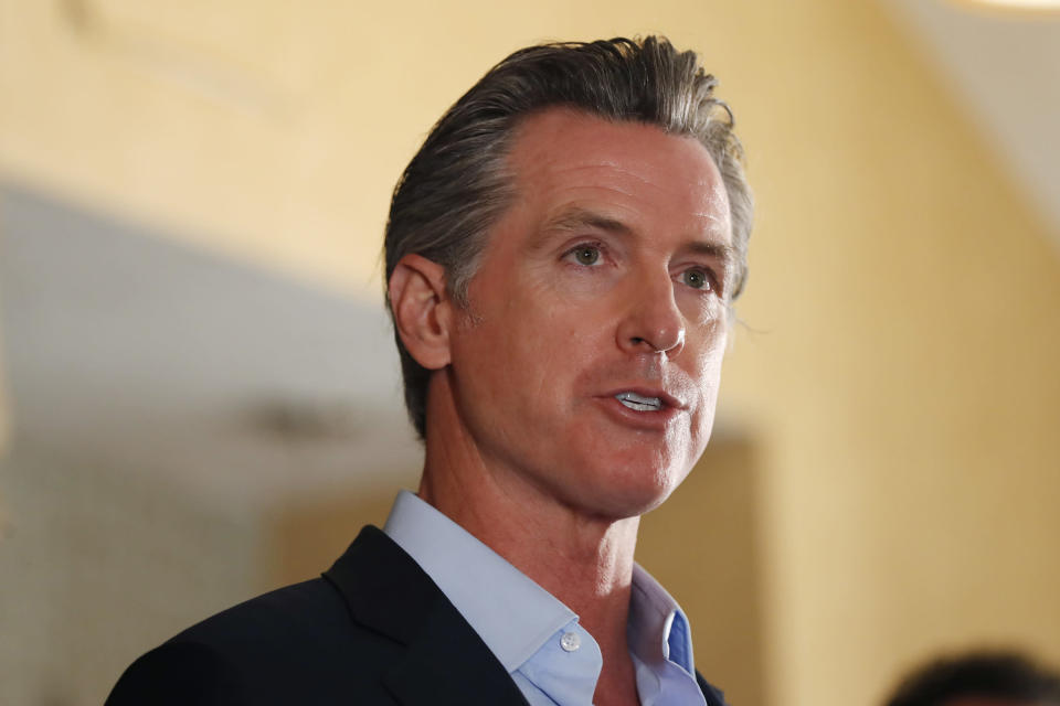 FILE - In this Tuesday, May 11, 2021, file photo, California Gov. Gavin Newsom speaks at a news conference at the Kearney Vista Apartments in San Diego, about a $12 billion package bolstering the state's response to the homelessness crisis. A fading coronavirus crisis and an astounding windfall of tax dollars have reshuffled California's emerging recall election, allowing Democratic Gov. Newsom to talk of a mask-free future and propose billions in new spending for schools and businesses as he looks to fend off Republicans who depict him as a foppish failure. (K.C. Alfred/The San Diego Union-Tribune via AP, File)